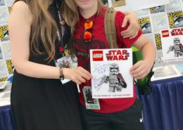 Ellen and a wonderful fan buying the first picture of Ellen as Captain Phasma in Lego:Star Wars
